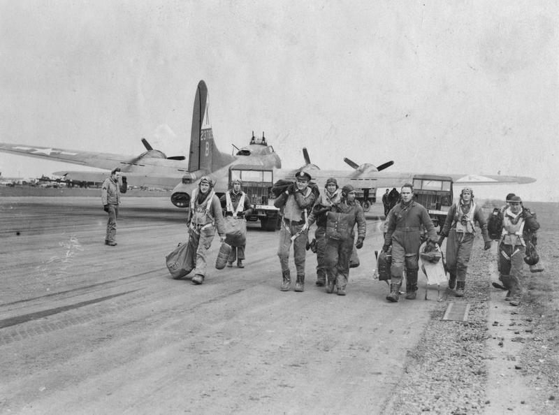 """A bomber crew of the 527th Bomb Squadron of 379th Bomb Group with their B-17 Flying Fortress 42-37805 FO-B """"Carol Dawn"""" on 11 February 1944. The crew is possibly that of Second Lieutenant Glen R. Hufnail. Most of the crew in this photo were MIA on 2 March 1944 over Belgium.   Passed for publication 12 Feb 1944.  Handwritten caption on reverse: '4-2-44.'  Printed caption removed from reverse. Censor no: 304545. On reverse: Associated Press, US Army Press Censor ETO and US Army General Section Press & Censorship Bureau [Stamps]."""