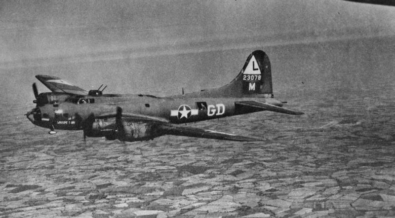 A B-17 Flying Fortress (GD-M, serial number 42-3078) of the 534th Bomb Squadron, 381st Bomb Group in flight. Handwritten caption on reverse: '381st BG.' On reverse: George J. Letzter [Stamp].