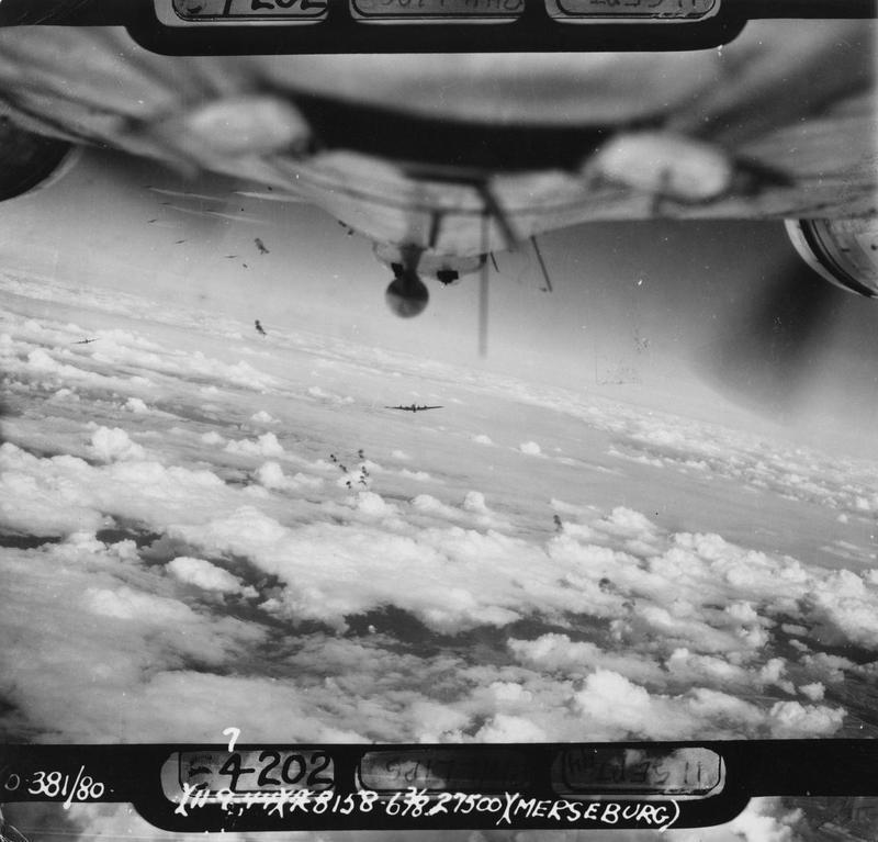 B-17 Flying Fortresses of the 381st Bomb Group fly through flak during a mission over Merseburg. Photographed from a B-17. Official caption on image: