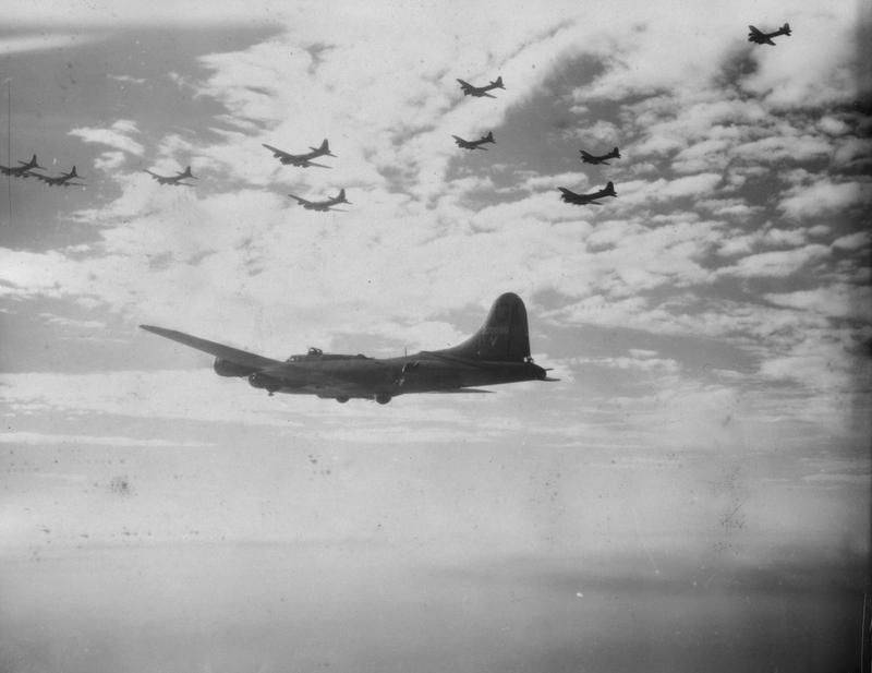 B-17 Flying Fortresses of the 385th Bomb Group fly in formation. Passed for publication 15 Nov 1943. Printed caption on reverse: 'U.S. Flying Fortresses In Action. Here is a series of pictures taken of Flying Fortresses over enemy territoty[sic] during a recent raid. These four engined