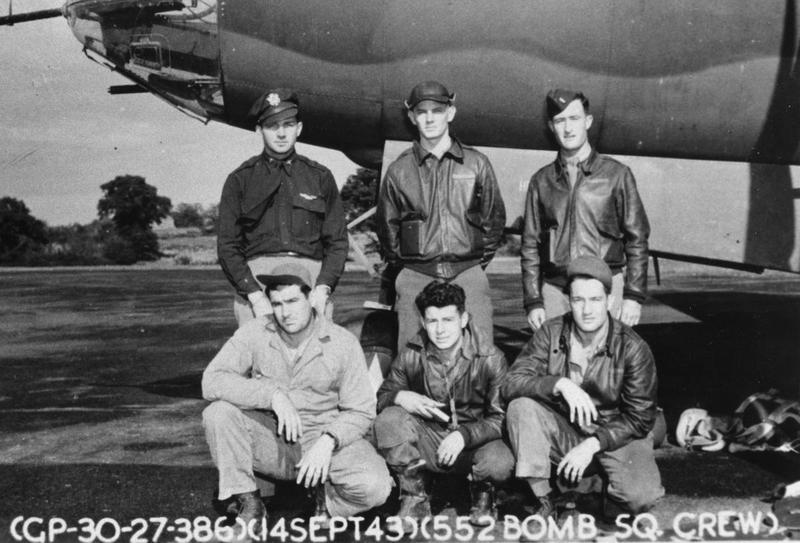 A bomber crerw of the 552nd Bomb Squadron, 386th Bomb Group with their B-26 Marauder (RG-K, serial number 41-34987).  Official caption on image: