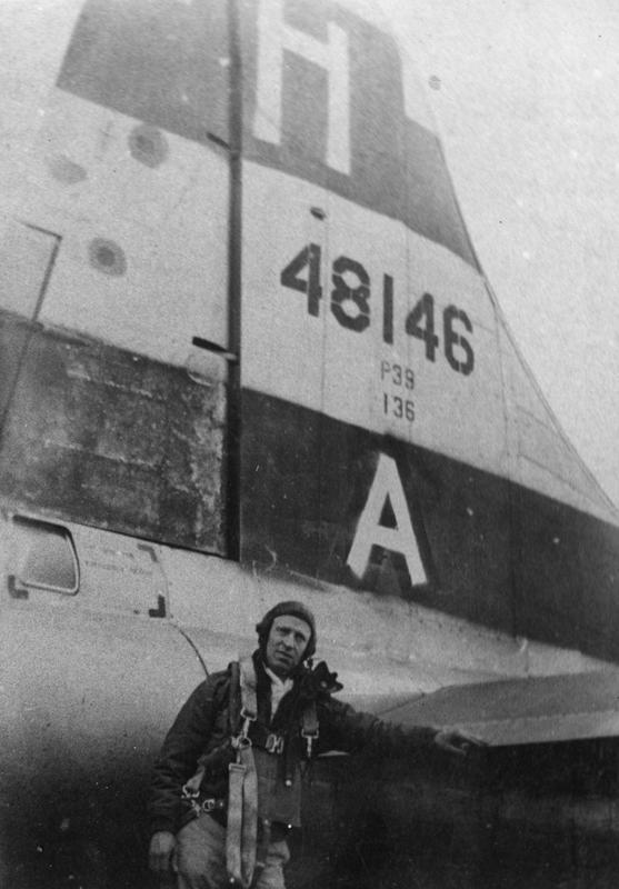 An airman of the 388th Bomb Group with a B-17 Flying Fortress (serial number 44-8146).