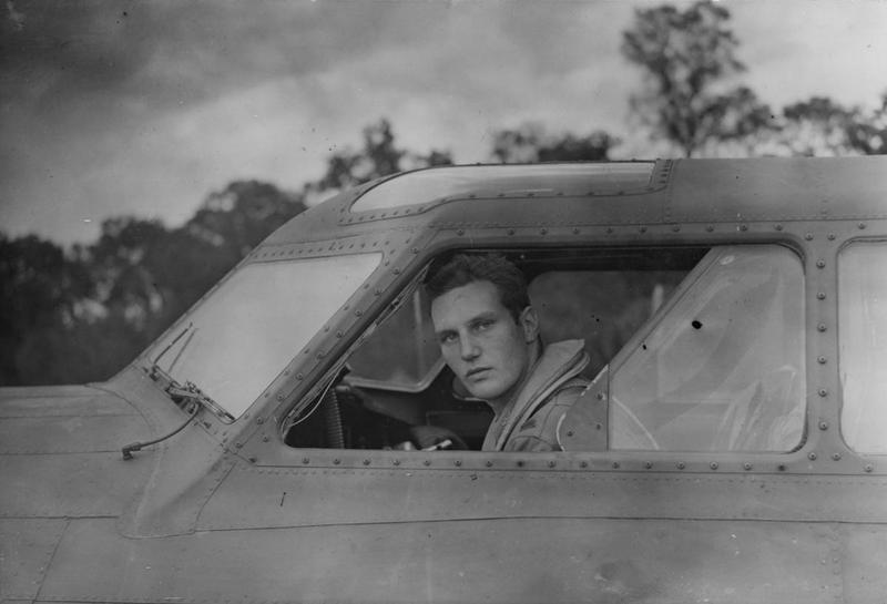 Second Lieutenant John G. Winant Jr a pilot of the 390th Bomb Group in the cockpit of his B-17 Flying Fortress nicknamed