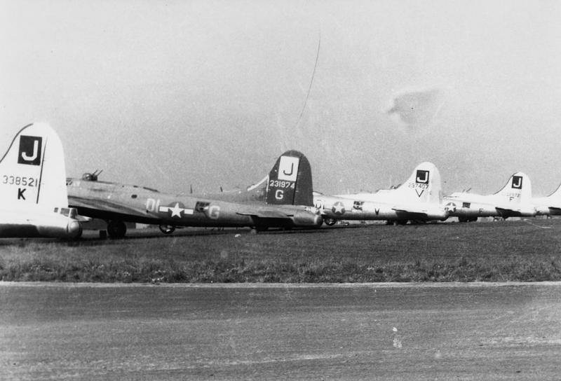 B-17 Flying Fortresses (serial number 43-38521), (DI-G, serial number 42-31974), (DI-V, serial number 42-97407) and (serial number 42-102972) of the 390th Bomb Group. Handwritten caption on reverse: '390BG.'