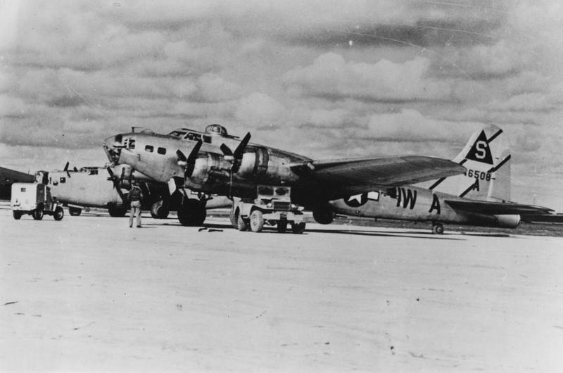 A B-17 Flying Fortress (IW-A, serial number 44-6508) of the 614th Bomb Squadron, 401st Bomb Group. Handwritten caption on reverse: '48.' On reverse: Griff Murphey [Stamp].