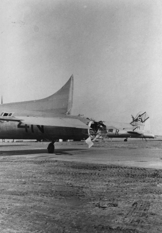 Damaged B-17 Flying Fortresses including (serial number 44-6146) of the 401st Bomb Group, and of the 486th Bomb Group. Handwritten caption on reverse: 'IN-R, 401BG.' A veteran has handwritten on reverse: 'Winter of 1944. This plane's bombardier was my best friend in high school. We joined the aviation cadets together in fall of 1942. Plane is from the 486th Bomb Group. It was struck in the rear by another plane in formation and tail gunner fell to his death over Germany. The Germans buried him and sent photo to his parents of tomb-stone which gave his home address as Indianapolis, Illinois instead of Indiana. This plane landed at the crash-landing base in Southern England. Bombardier was 1st Lt. Delmar Claussen of Sioux Falls, So. Dakota. He claims to be a German ace as he bailed out once and crashed 4 times.'