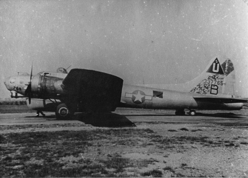 A B-17 Flying Fortress of the 748th Bomb Squadron, 457th Bomb Group ('B', serial number 43-37765) at Glatton airfield. Handwritten caption on reverse: '748.'