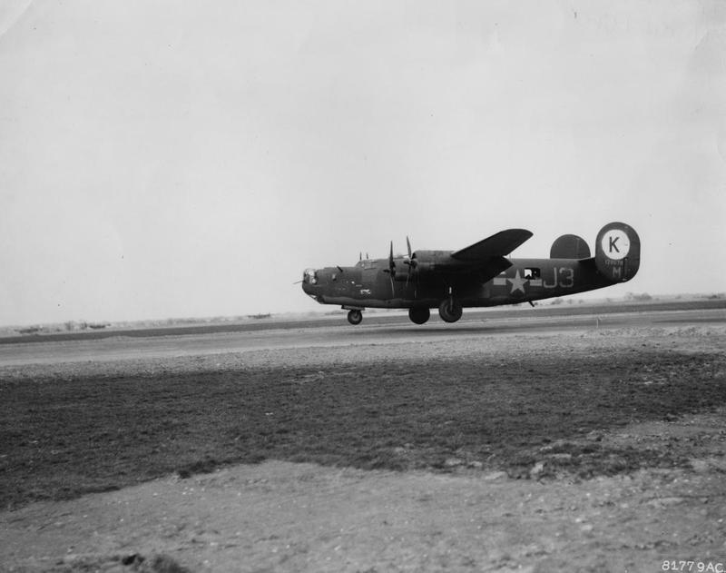 A B-24H Liberator (J3-M, serial number 41-28678) of the 755th Bomb Squadron, 458th Bomb Group lands at Horsham St. Faith , March 1944. Handwritten caption on reverse: 'B-24H of 458th Bomb Group landing at Horsham St. Faith, Norfolk in late March 1944. 6 Foot Dix.' Second handwritten on reverse: '458 B.G., 8th Air Force.' Printed caption on reverse: '81779 AC - Consolidated B-24 of 458th Bomb Group arrives at air base somewhere in England after completing 200th mission, 1944. U.S. Air Force Photo.'
