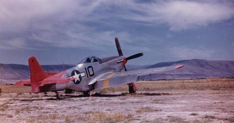 A P-51 Mustang (10) of the 332nd Fighter Group. Handwritten caption on reverse: 'Genuine WWII colour photo, Mustang Fossia (sp. Foggia) Italy.' Printed caption with image: 'A/C of negro 33nd (332nd) FG.'  P-51D-15-NA #44-15648