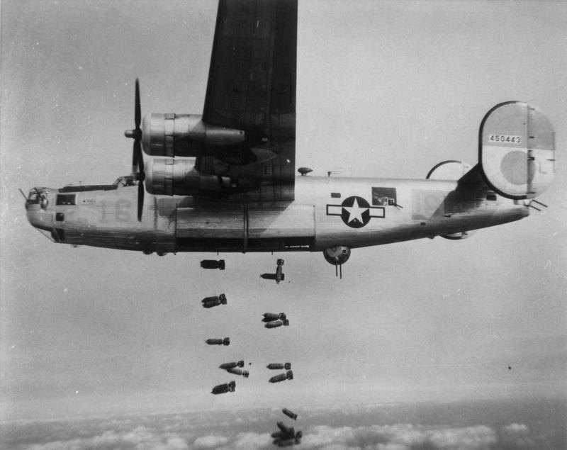 A B-24 Liberator (serial number 44-450443) of the 451st Bomb Group, 15th Air Force releases bombs during a mission.
