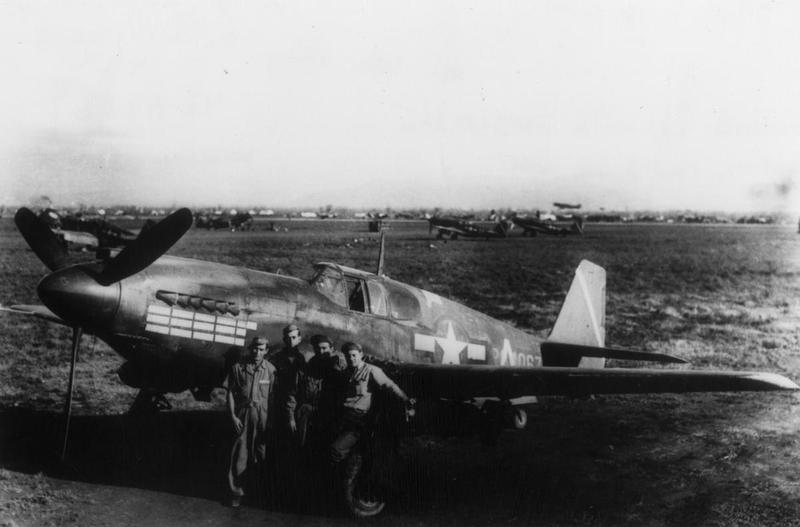 Personnel of the 27th Fighter Bomber Group, 12th Air Force with an A-36 Mustang (serial number 42-84067) in Sicily. First handwritten caption on reverse:'27th F Bo Group. 12 AF A/C ABC Letter added.' Second handwritten caption on reverse: 'Bombed up with 500lb HE. Mission record on nose, 27th Fighter Bomber Group on Sicily Base, 1943. 42-84067 Veteran A-36A.'