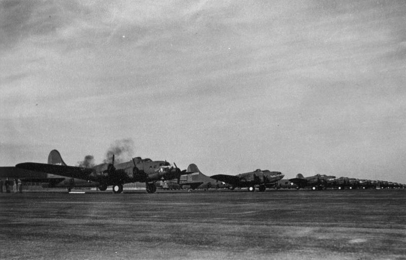 B-17 Flying Fortresses, destined for the 305th Bomb Group, lined up in Gander. Handwritten caption on reverse: '41-24604