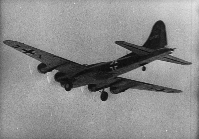 A B-17F Flying Fortress (serial number 41-24585) formerly of the 303rd Bomb Group, in Luftwaffe markings after being captured by the Germans. Handwritten caption on reverse: '303BG lost 12/12/42.'