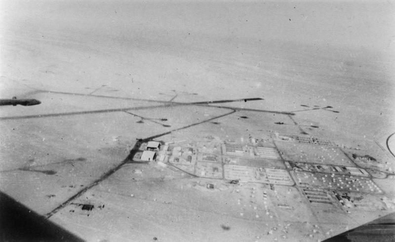 Fayid Airbase in Egypt, home of the 98th Bomb Group, photographed from a B-24 Liberator. Handwritten caption on reverse: 'Airfield + station RAF Fayid ME, 1941.'