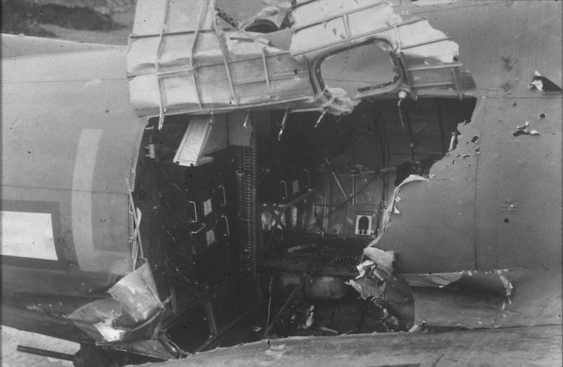 A battle damaged radio room position on a B-17 Flying Fortress of 100th BG. A direct hit by an 88mm killed the radio operator in Miss Irish , flown by John P