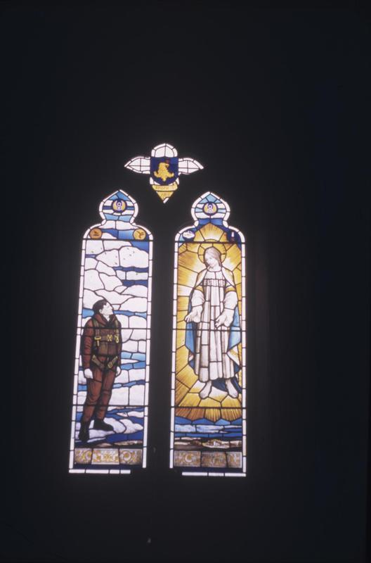 A commemorative stained glass window, dedicated to airmen of the 96th Bomb Group. Written on slide casing: '1945, window in church of Eccles Rd, Engalnd. Dedicated to missing airmen of 96th Bomb Grp.'