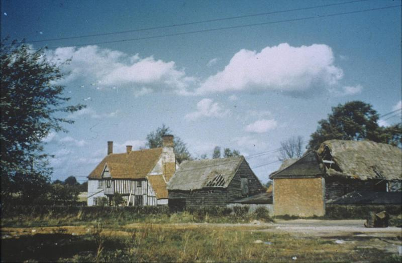 A farm near Wormingford. Image by Robert Sand, 55th Fighter Group. Written om slide casing: 'Jenkins Farm, Wormingford.' Caption from Sand's file. Slide 3-6