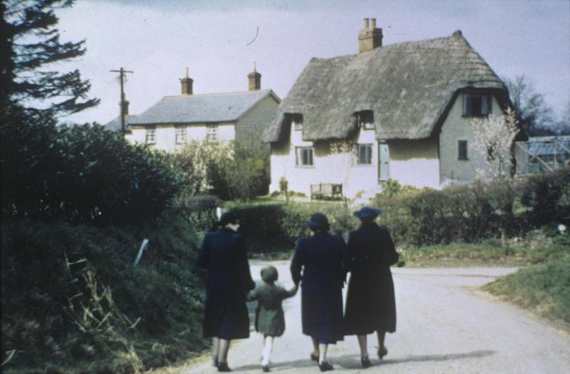 Ladies walking in Anstey, Hertfordshire. Image by Robert Sand, 55th Fighter Group. Written on slide casing: 'Anstey, Hamlet near Nuthampsted.'