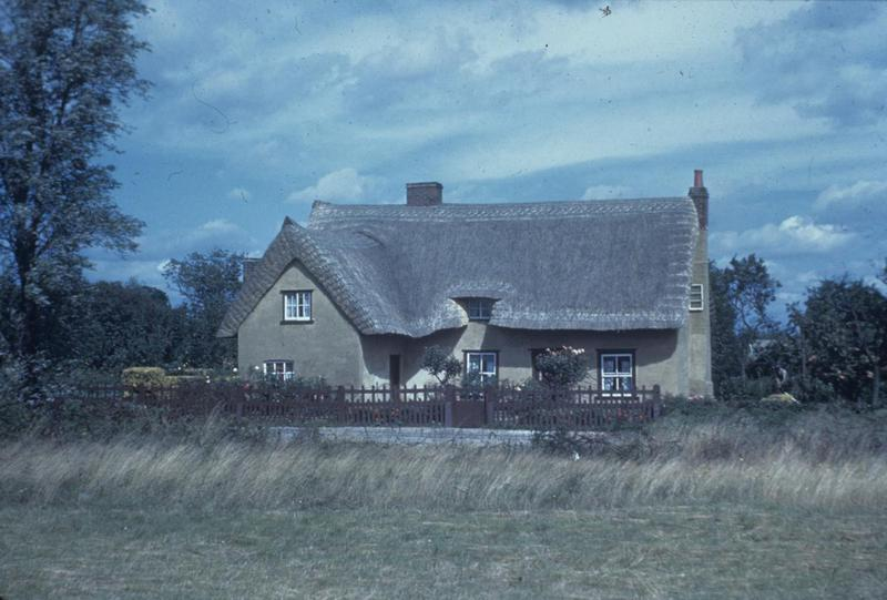 A thatched cottage in Langham, Essex. Image by Robert Astrella, 7th Photographic Reconnaissance Group . Written on slide casing: 'Langham, Ex.'