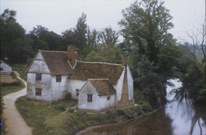 Willie Lot's Cottage at Flatford Mills. Image by Robert Sand, 55th Fighter Group. Written on slide casing: 'Willie Lot's Cottage Flatford Mills.' Caption from Sand's file. Slide 4-55
