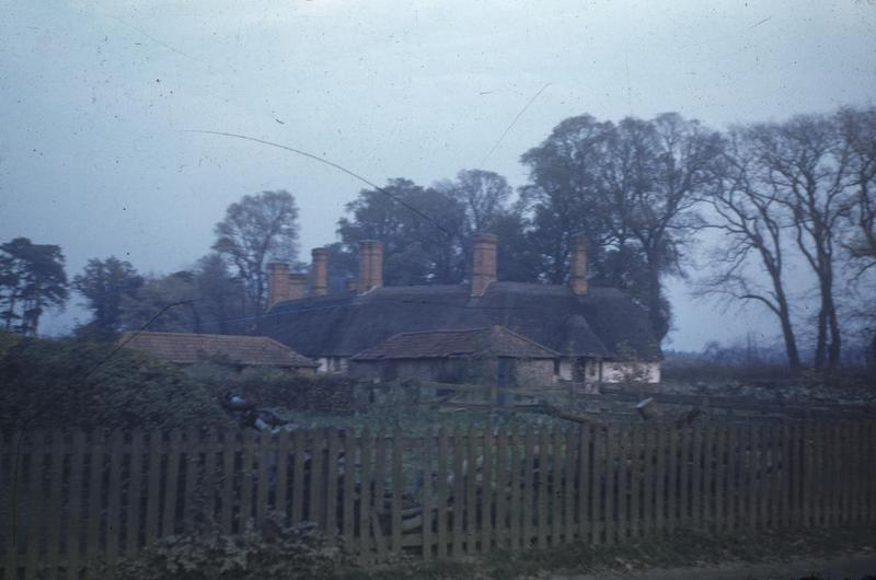 Thatched cottages in Homersfield, photographed by an airman of the 466th Bomb Group. Image via George Parker. Written on slide casing: 'Almshouses, Homersfield.'