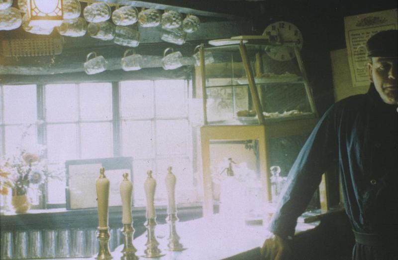Interior of The Fighting Cock pub in St Albans. Image by Robert Sand, 55th Fighter Group. Written on slide casing: '4-66, The Fighting Cock, St Albans.'