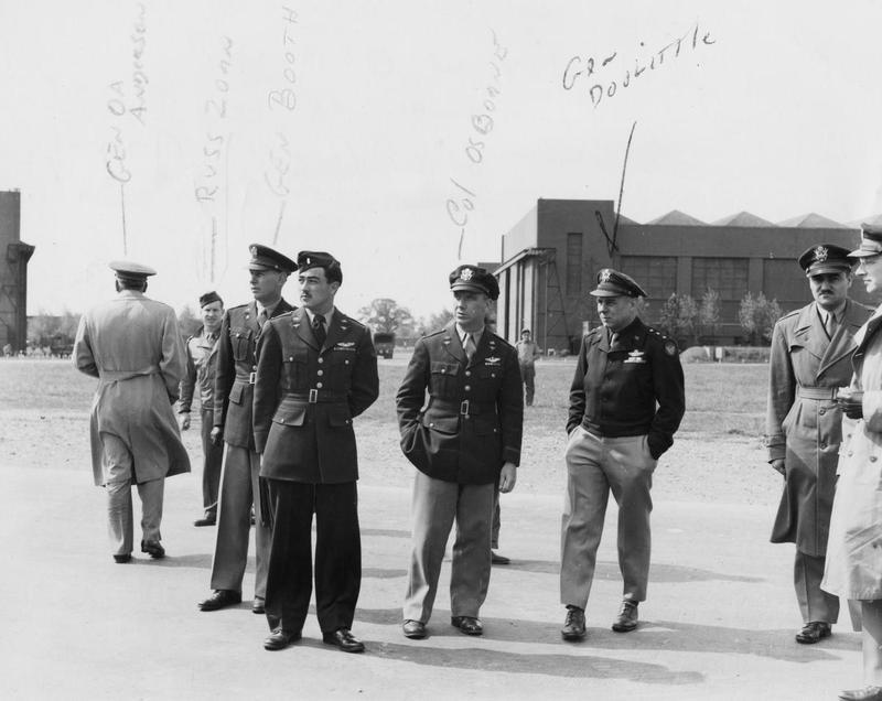 General Anderson, Russ Zorn, General Booth, Colonel Roy Osborn and General Doolittle at Honington, home of the 364th Fighter Group.   First handwritten caption on reverse: 'Standing next to Gen Doolittle Col Roy W Osborne, Commander of 364th Fighter Group, Honington Air Base.' Second handwritten caption on reverse: 'The Lt in from 364th FG also something like Greenlin.'