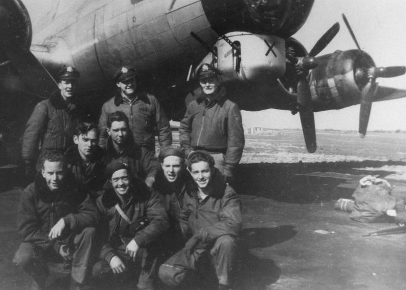 A bomber crew of the 486th Bomb Group with their B-17 Flying Fortress (serial number 43-38001) nicknamed