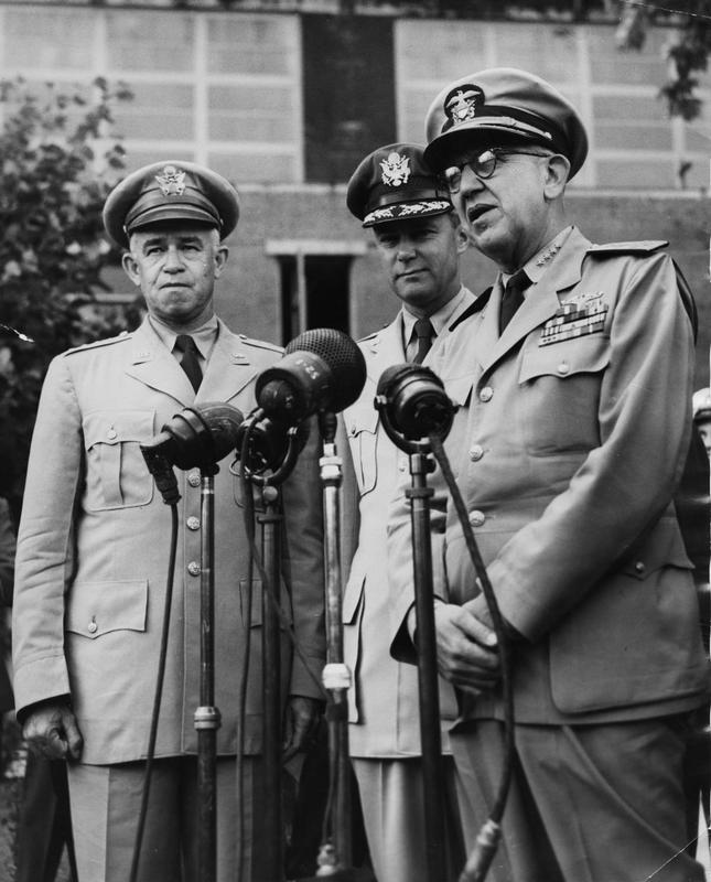 General Bradley, General Vandenberg and Admiral Denfield at Northolt airport. Image stamped on reverse: 'International News Photos., picture by E Wing.' [stamp] Printed caption on reverse: 'US CHEIF OF STAFF ARRIVE AT NORTHOLT 2.8.42. The US Join chiefs of Staff, General Bradley, Admiral Denfield and General Vandenberg, flew into Northolt Airport tonight for talks with British Defence Chiefs. Tey will be leaving again on Friday on their fact finding tour of Europe. INP Photo Shows: Left to Right: General Bradley, General Vandenburg and Admiral Denfield on their arrival at Northolt tonight.'