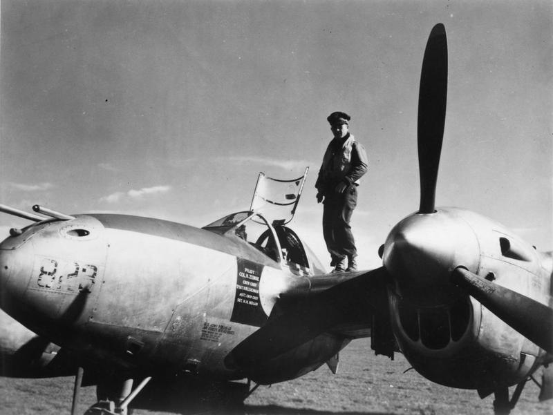 Colonel Hubert Zemke of the 479th Fighter Group on the wing of P-38J-15-LO,  s/n 43-28823 coded J2-Z. Aircraft was later transferred to the 428th Fighter Squadron, 474th Fighter Group. This ship was lost to flak just south of Manhay, Belgium on 25 December 1944. The pilot, 1Lt. Bobby R. Rankin, was KIA (MACR 11900).