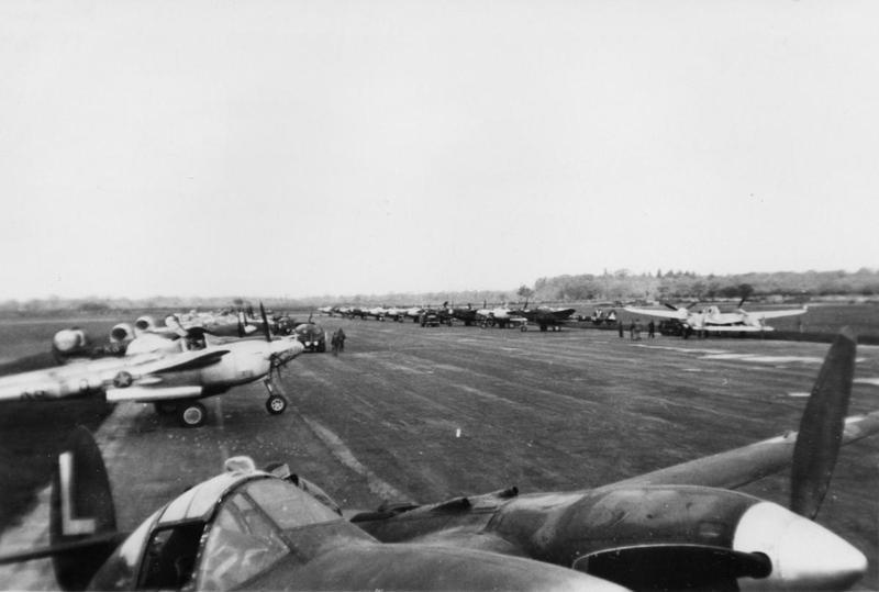 P-38 Lightnings of the 474th Fighter Group lined up on hardstanding. Handwritten caption on reverse: '474 Leicester, 19 May 44, K6 White Yellow, 7Y Dark.'