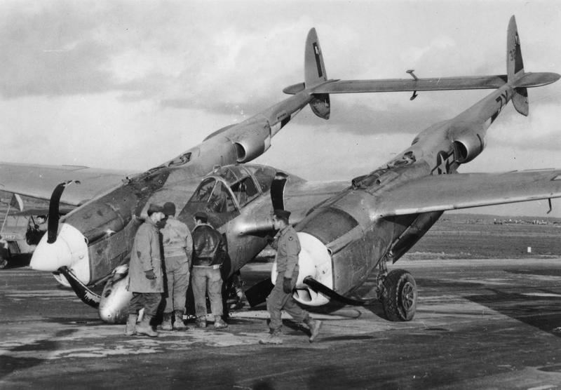 Ground personnel of the 474th Fighter Group inspect a 429th Fighter Squadron P-38J-15-LO, s/n 43-28366, coded 7Y-I. On 26 November 1944, the aircraft experienced a flat tire upon landing at airfield A-78 Florennes, Belgium causing the nose gear to collapse. The pilot, 2Lt. Milton R. Graham, was OK. This ship was transferred from the 364th Fighter Group.