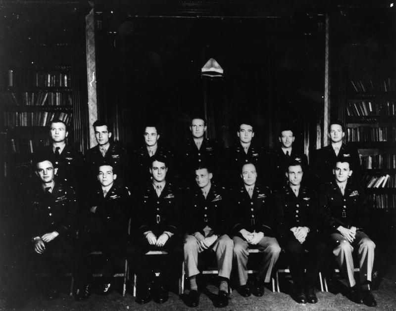 Commanding officers of Fighter Groups of the 8th Air Force, 1944.  Printed caption on reverse: 'FORMAL PORTRAIT: They are, left to right, front row:  Hub Zemke, 479th Grp,  Roy Caviness, 361st Grp,  Dave Schilling, 56th Grp,  Everett Stewart, 355th Grp,  Ben Rimerman, 353rd Grp,  John Henry, 339th Grp,  Tod Crowell, 55th Grp.   REAR: James Mayden, 352nd Grp,  WH Swanson, Unk,  Joe McManus, 364th Grp,  Claiborne Kinnard, 4th Grp,  Philip Tukey, 356th Grp.  Fred Gray, 78th Grp,  Don Graham, 357th Grp.  Date is unknown but it has to be from late August 1944 no later than 30 oct when Hub [Zemke] became a POW. On 12 Aug, Hub went to 479th and Dave Schilling took over 56th. Don Graham gave up 357th on 10 Oct, so it has to be before that. Missing are COs from 20th (Col Harold Rau, and 359th, Colonels Jacon or Randolph.) Now, one would guess that they were not available and maybe their deputy comdr sat in for them, whic would mean Swanson or Crowell. However, neither man is on the 30th Grp rosters (I have complete one) and I cannot find either name anywhere in the records. So that will remains a mystery for now. I have not used any ranks, but all would be Lt Col or Colonel. I hope you enjoy these as much as I do trying to solve these 50 plus year old mysteries!! PS Forgot to mention, I do not know location. I have a note that it might have been Bottisham, but I don't know where I got that.'   Handwritten caption on reverse: 'Bushey Hall Library.'