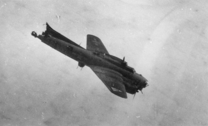 A B-17 Flying Fortress of the 384th Bomb Group, 546TH Bomb Squadron falls towards the ground after having its tail shorn off by falling bombs during a mission to Berlin, Ball turret gunner and waist gunner were able to bail out at 5,000 feet, 9 March 1944. MACR 3005. 42-37781.