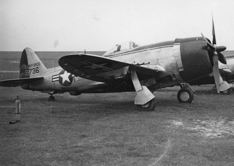 A P-47 Thunderbolt (serial number 9736) formerly of the 86th Fighter Group, in Munich. Handwritten caption on reverse: 'Ex 86 FG, Red cowling & rudder.'