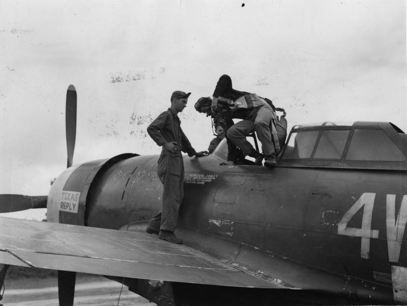 Lieutenant Colonel Jim Daley of the 371st Fighter Group climbs out of his P-47 Thunderbolt after a mission. Image stamped on reverse: 'Keystone Press.' [stamp], 'Passed for publication 11 Aug 1944.' [stamp] and '349044.' [Censor no.] Printed caption on reverse: 'MEET LT COL DALEY OF 9TH AIR FORCE FIGHTER GROUP NO BASE IN NORMANDY. Photo shows: Lt Col Jim Daley gets out of his Thunderbolt. He is the group deputy CO and comes from Amarillo, texas.'  'Texas Reply' is more than likely 4W-D(Bar) P-47D-20-RE 42-76522, which Daley flew on the majority of his missions with the 406th.  of 406FS, 371FG, 9AF. Lt Col William James 'Jim' Daley.