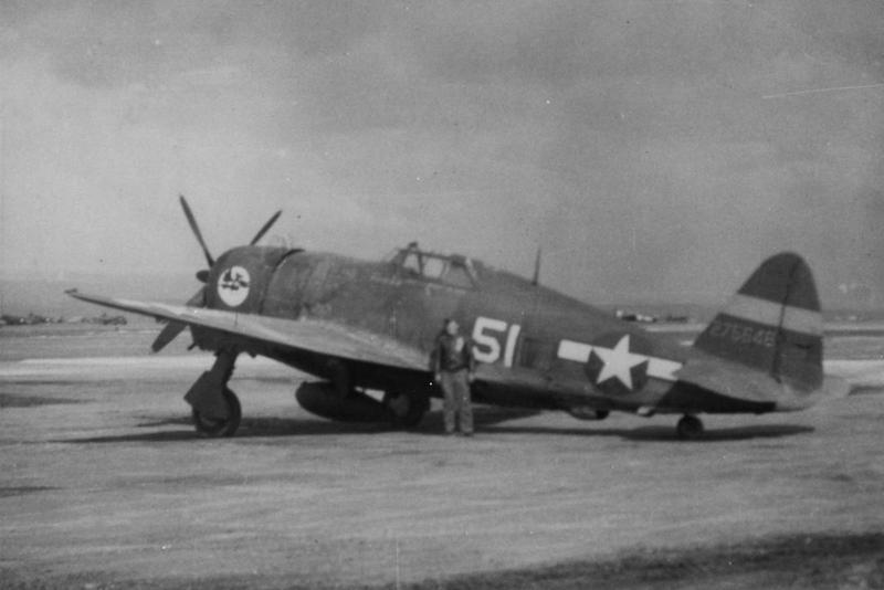 Lieutenant Froning of the 57th Fighter Group, 12th Air Force with his P-47 Thunderbolt (51, serial number 42-75546). Handwritten caption on reverse: '57th Ftr Grp, Lt Froning.'