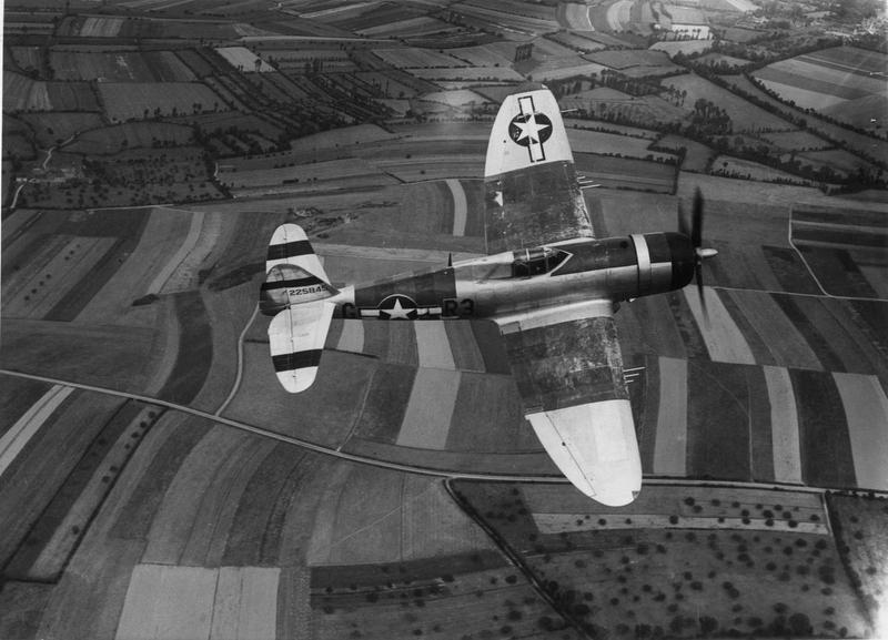 A P-47 Thunderbolt (R3-G, serial number 42-25845) of the 373rd Fighter Group in flight. Image stamped on reverse: 'Charles E Brown.' [stamp], 'Passed for publication 7 Sep 1944.' [stamp] and '356662.' [Censor no.] Printed caption on reverse: 'P-47 Thunderbotl flying across open country.'