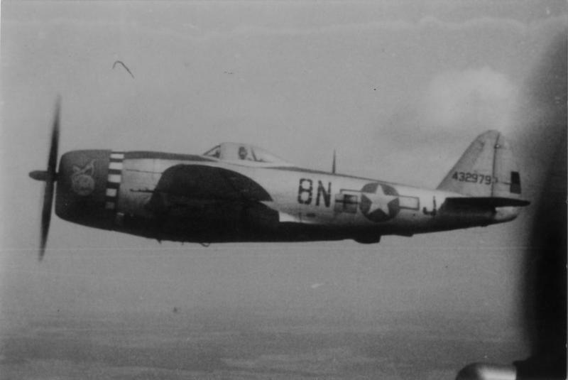 A P-47 Thunderbolt (8N-J, serial number 44-32979) of the 371st Fighter Group in flight.