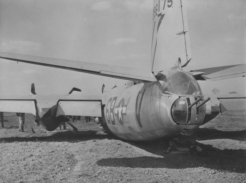 The tail and rear half of a belly-landed 599th Bomb Squadron, 397th Bomb Group B-26 Marauder (6B-V, serial number 42-96175). Handwritten caption on reverse: 'Martin B-26-55-MA, R. Bowers. 397BG, 599BS.'