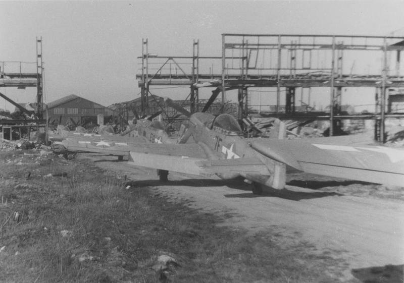 A line of P-51 Mustangs, formerly of the 370th Fighter Group, 485th Fighter Squadron ('7F') and 402nd Fighter Squadron ('E6') in Fürth at 1948, assigned to head to Sweden. Handwritten caption on reverse: '1948. Furth For Sweden. Tage Danielsson. 370th F.G., 485th F.S., 9th Air Force.'
