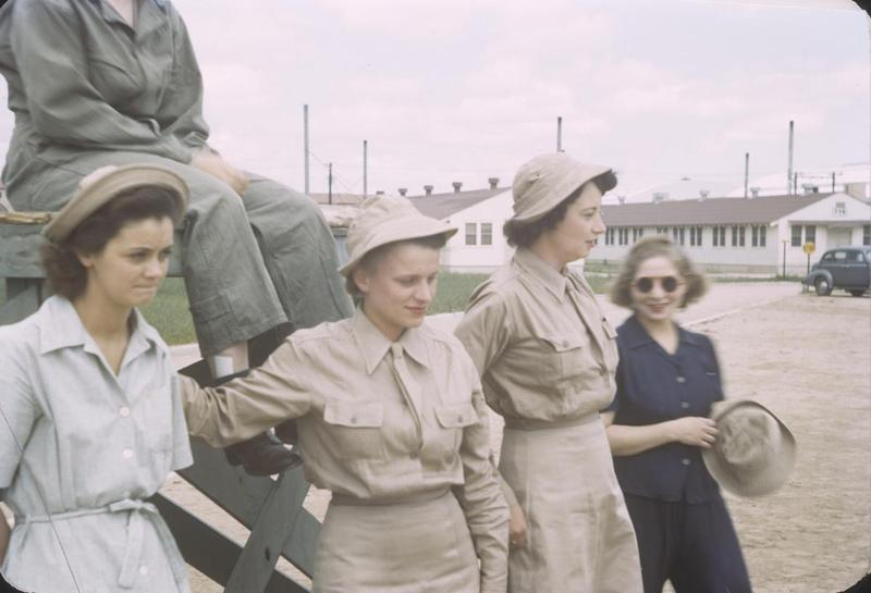 Five personnel of the Women's Army Corps in Tunisia serving near Lieutenant J. Driscoll, of the 566th Bomb Squadron, 389th Bomb Group. Handwritten on slide casing: 'WACS, 2AD.'