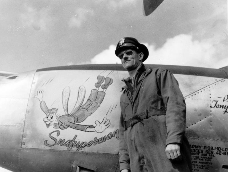 Anthony W 'Tony' Levier, test pilot for Lockheed poses with the nose art of a P-38 42-68008 Lightning P-38J