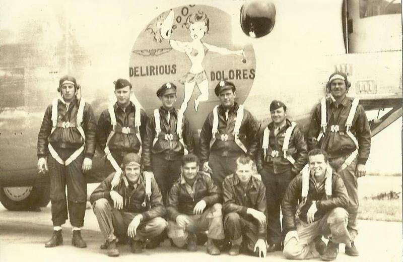 The Delirious Dolores (44-40200) shortly after arrival at Metfield, June 1944. The aircraft was named after pilot James C. McKeown's wife Delores. McKeown Crew: rear, L to R, (G) George McGee, (N) Ross Houston, (CP) Robert McIntyre, (P) James McKeown, (B) George Patton, (E) Francis Hawkins, front, L to R (RO) Joseph Rimassa, (G) Marshal Williams, (G) Frederick Borger, (G) John Murray. McKeown was severely wounded on 14 June 1944 over St. Cyr. The Delirious Dolores crashed with a replacement crew after returning from Saarbruken on 13 July 1944. (P) Max R. Shea, (CP) Charles A. Meadow, (N) Harold F. Simon, (TG) Percival M. Lewis, (RG) Solon W. Elliot Jr. were KIA and the aircraft was destroyed. Most of McKeown's crew continued to fly on the Moose (44-40205) piloted by Warren C. Moore which, along with the rest of the 853rd Bomb Squadron, was shot down over Misburg on 26 November 1944. Borger, Hawkins, Murray, Patten, and Williams were KIA. Houston, McGee, McIntyre, and Rimissa spent the rest of the war as POWs.