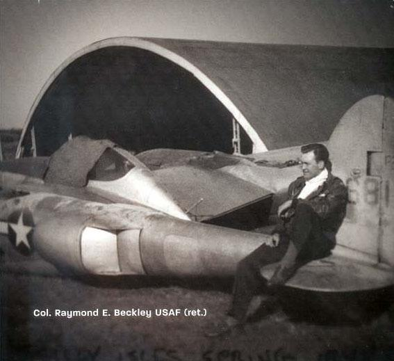 Col. Raymond E. Beckley and his damaged aircraft.