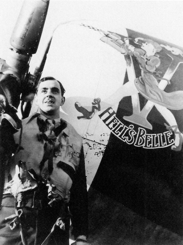 2nd Lt.  Charles F. Anderson pose next to the nose of his P-47D Thunderbolt 42-74726, 'HELL'S BELLE', in which he claimed a Bf 109 destroyed and a second damaged on 30 January 1944.