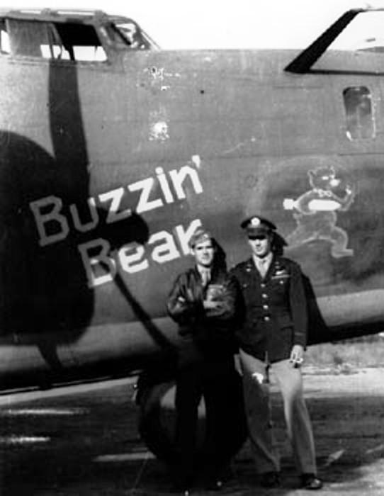 B-24D-25-CO Liberator 41-24229 -  'Buzzin Bear' of the 67th Bomb Squadron - the 44th Bomb Group - and the 8th Air Force.  Pilot Maj. Bill Cameron  - right.   -  1st Lt. James F. Devinney - Bombardier - left.   Name, 'Buzzin Bear' on Starboard / Right Side - Renamed from 'SEEDS O-SATAN' - Port side has  'MISS DELORES'  Survived Operation Tidal Wave , Ploesti, Romania.    Aug 1, 1943.