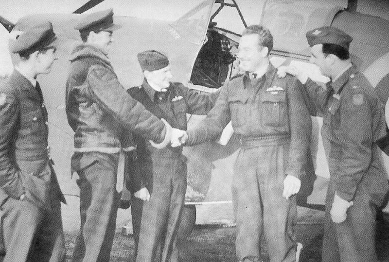 Then Pilot Officer Carroll W. McColpin being congratulated on receiving his RAF DFC whilst serving in the 'Eagle' Squadron.