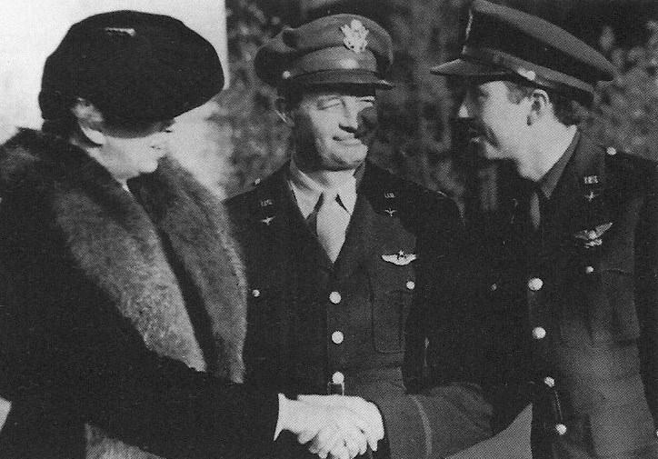 First Lady Mrs Eleanor Roosevelt with Colonel Edward Wharton Anderson (centre)  - first Commanding Officer of the 4th Fighter Group, meet its pilots on 4 November 1942 at Debden.