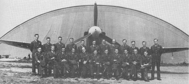 Pilots and Officers of No. 133 (Eagle) Squadron at Biggin Hill, June 1942. Standing L-R: Lt. Leonard T. Ryerson, Lt. George H.  Middleton, R. Beatty, E. Miller, D. Gudmundsen, D. Lambert, Dominic S. Gentile, J. Emerson (Intelligence Officer), F. Chapman (Medical Officer), J. Stavely-Dick (Adjutant), Grant E. Eichar and Carl H. Miley. Sitting L-R: G. Harp, William Arends, G. Omens, E. Taylor, Coburn C. King, T. Thomas (Commanding Officer), Donald J. M.Blakeslee, George B. Sperry, E. Doorley, K. Kimbro and W. Baker.